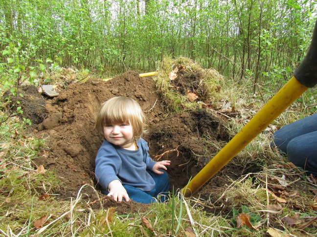 C 'helping' dig a test hole