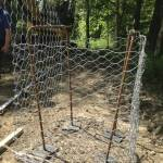 Wire cage to be sunk in the ground and filled with aggregate.