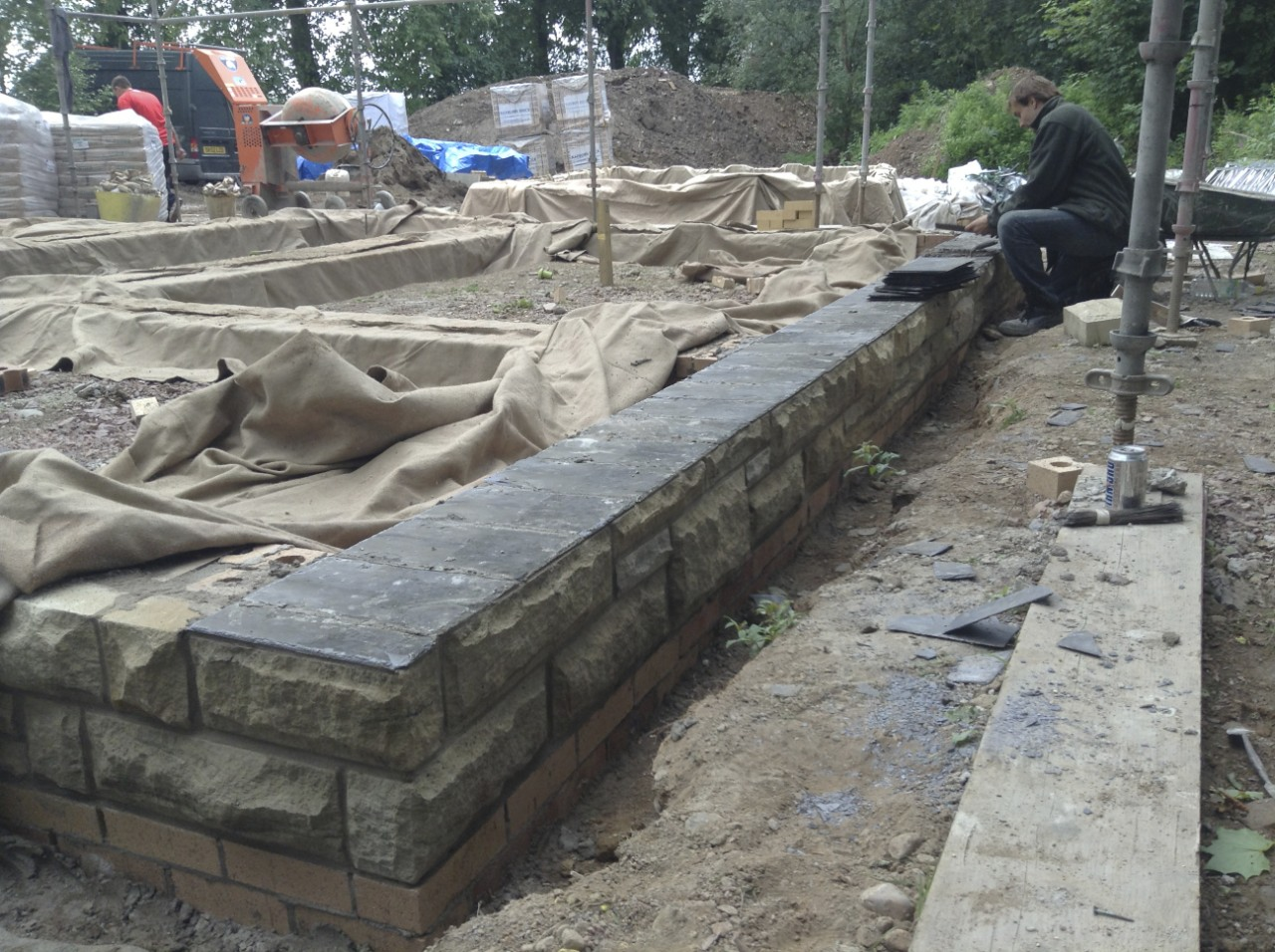 Slate laid as a damp proof course along the north west wall of the