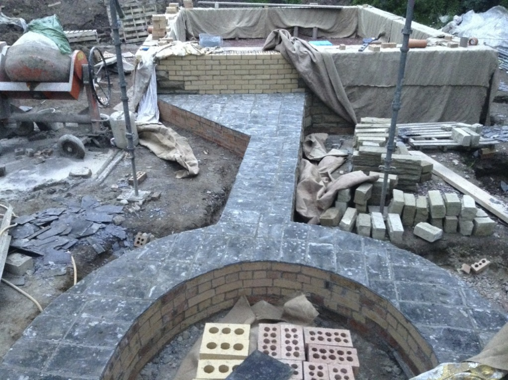 DPC on the curved boot room wall and the wall for the outdoor covered area and fireplace