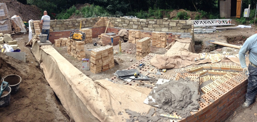 Building the plinth walls for the Peerie Hoose and outdoor fireplace